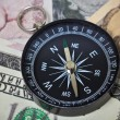 Stock Photo: Internation currencies with compass