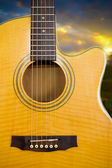 Yellow acoustic guitar — Stock Photo
