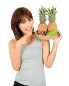 Isolated young asian woman with variety of oriental fruits. — Stock Photo