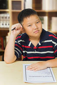 Young asian boy upset with his exam result — Stock Photo