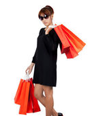 Isolated young asian woman carries shopping bags — ストック写真