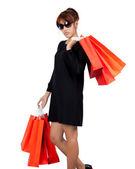 Izolované mladá asijská žena nese nákupní tašky — Stock fotografie
