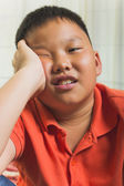 Young asian boy with upset expression — Stock Photo