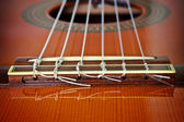 The bridge of a classical guitar — Stock Photo