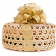 Gold ribbon on a bamboo cage gift set — Stock Photo
