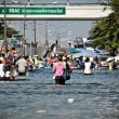 Постер, плакат: People evacutaes from the flood
