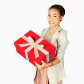 Young Business Woman with with a red present box — Stock Photo