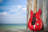 Red Old Electric Guitar on a Dock by the Sea — Stock Photo