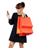 Young asian woman carries shopping bags — Stock Photo