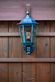 Lamp on a Wood Fence — Stock Photo