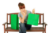 Isolated Young Asian woman with Green Shopping Bags — Stock Photo