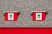 Small Windows of an Attic on The Roof of a Red House — Stock Photo