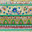 Thai patern wall attached with small piece of ceramics — Stock Photo