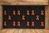 Violins hung on the wall — Stock Photo