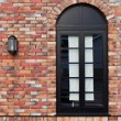 Black window on a Brick Wall  — Stock Photo