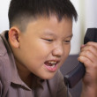 Young asian boy scold at the telephone — Stock Photo