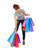 Isolated young Asian woman with shopping bags — Stock Photo