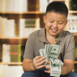 Asian boy with U.S . dollar bank notes — Stock Photo