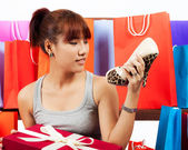 Isolated young Asian woman with shopping bags — Foto Stock