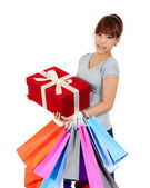 Isolated young Asian woman with shopping bags — Stok fotoğraf