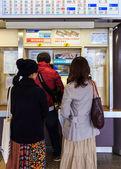 Fukuoka, Japan - November 13 2013: Unidentified people buy train — Stock Photo