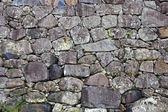 Japanese temple wall composes of various size of stone — Stock Photo