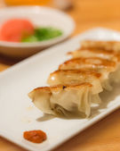 Homemade Asian pork gyoza on a white plate — Stock Photo