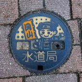 Momotaro character on a Manhole in Okayama — Stock Photo