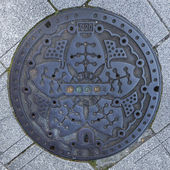Manhole cover in Tokyo — Stock Photo