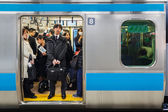 Japanese Commutors on a Train in Tokyo — Stock Photo