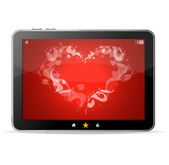 Black tablet like Ipade on white background ang heart on red — Stock Vector
