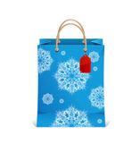 Christmas shopping bag with snowflakes — Stock Vector