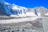 Mountain landscape with glacier and stone screes — Stok fotoğraf