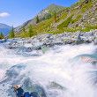 Mountain landscape with fast river — Stock fotografie