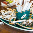 Stock Photo: Ashtray with cigarette butts