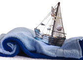 Baby towel and a toy ship — Stock Photo