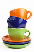 Multicolored teacups and saucers — Stock Photo
