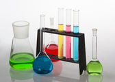 Laboratory glassware filled with various coloured liquids. — Stock Photo