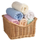 Fluffy towels in a basket. — Stock Photo