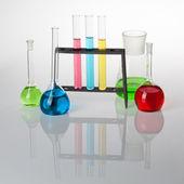 Set of laboratory glassware filled with multicolored liquids, wi — Stock Photo