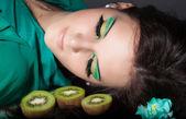 Beautiful woman with green make-up — Stock Photo