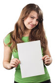 Young woman showing white blank placard — Stock Photo
