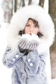Winter woman Blowing Snow — Stock Photo