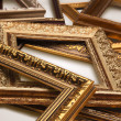Heap of gold antique frames — Stock Photo