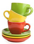 Stack of multicolored tea cups and saucers — Stockfoto