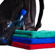 Towels and backpack with bottle of water — Stock Photo #50931595