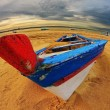 Boat at sunset on beach — Foto de Stock