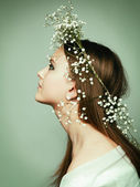 Spring portrait girl with wreath of flowers — Stock Photo