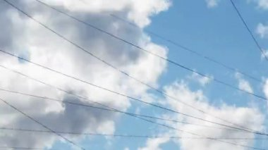 Clouds over power lines and building, Time Lapse — Stock Video