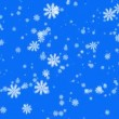 Snowflakes on blue background - Stock Photo